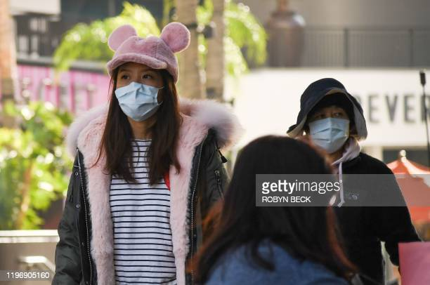 Visitors to the Hollywood Highland mall in Hollywood wear face masks on January 27 2020 Five people in the United States have tested positive for the...