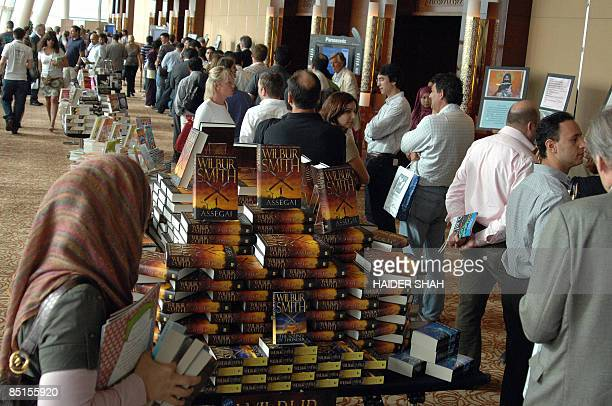 Visitors to the International Festival of Literature in Dubai wait to attend a lecture by British author Louis De Berniers on February 28 2009 The...