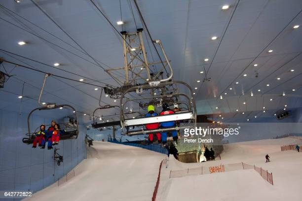 Visitors to the Mall of the Emirates indoor ski slope take the chair lift to the top The Mall of the Emirates is a premier shopping mall in the Al...