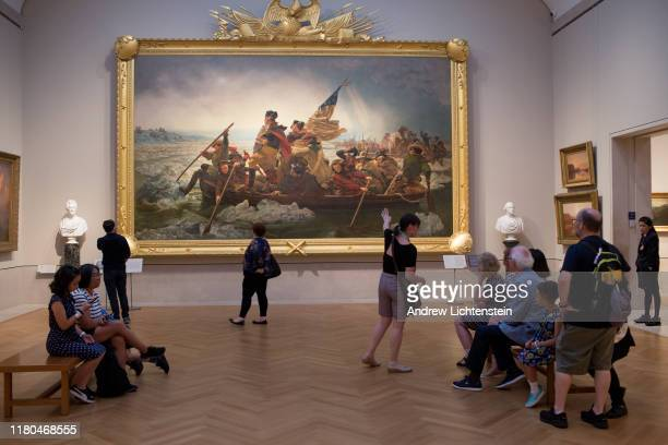 "Visitors to the Metropolitan Museum of Art's American wing view Emanuel Leutze's painting ""Washington Crossing the Delaware in 1776"" on August 30,..."
