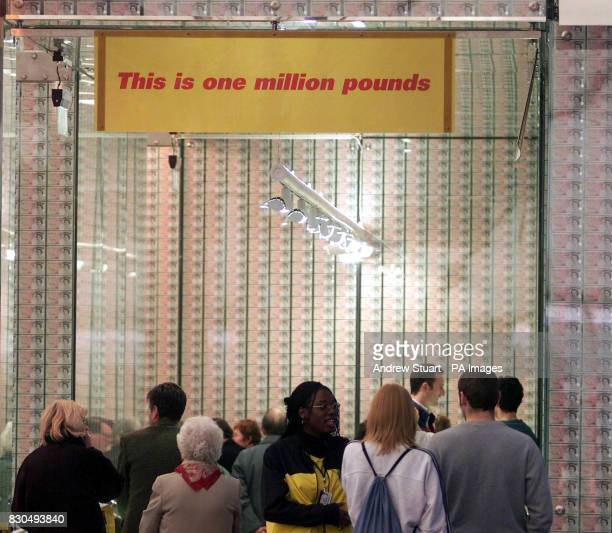 Visitors to the Millennium Dome's Money Zone where there are twenty thousand cancelled 50 pound notes totalling one million pounds A damning offical...