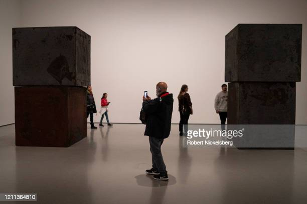 Visitors to the Museum of Modern Art view Richard Serrau2019s 320ton sculpture called Equal in New York City on March 7 2020 The sculpture is...