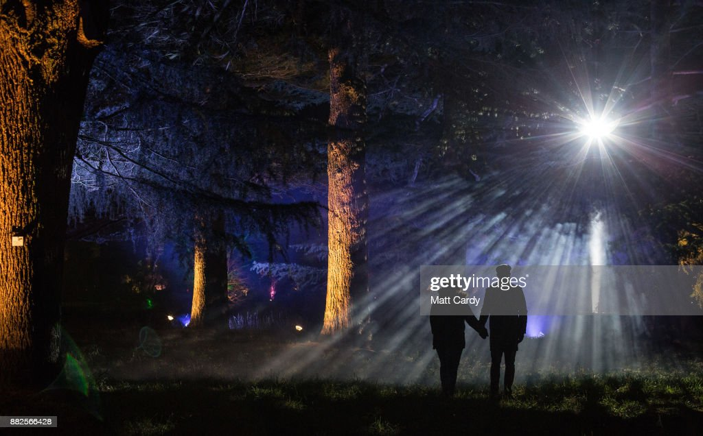 Visitors to the National Arboretum look at the illuminations at the launch of Enchanted Christmas attraction at Westonbirt Arboretum near Tetbury on November 29, 2017 in Gloucestershire, England. The popular annual attraction, which features illuminations and interactive features along the trail, will take place on long weekends from the 1 December until 18 December.