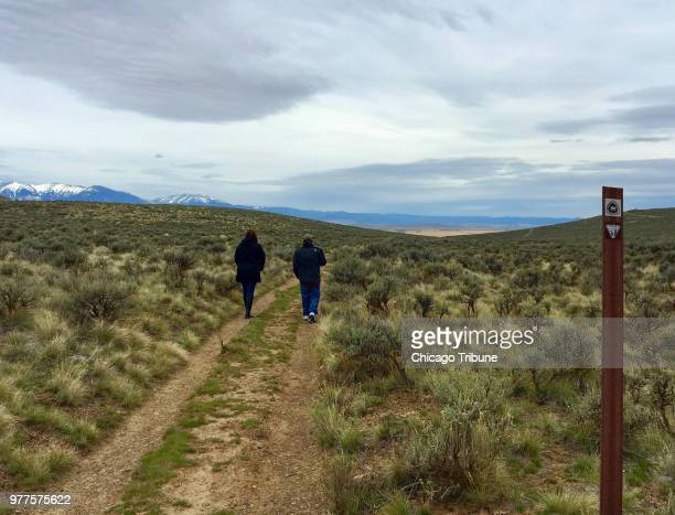 Visitors to the National Historic Oregon Trail Interpretive Center outside Baker City Ore walk in the ruts formed when hundreds of thousands of...