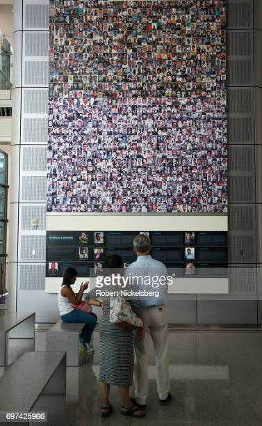 Visitors to the Newseum look at a memorial display of over 250 photographs and descriptions of journalists killed around the world over recent years...