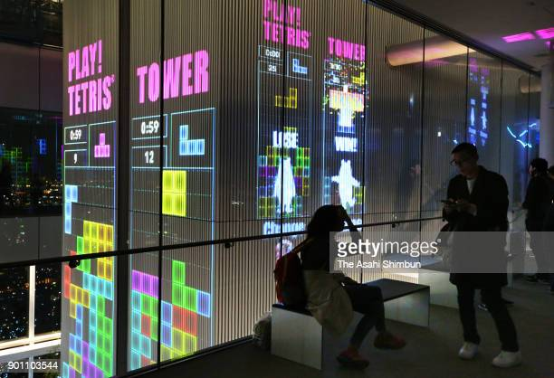 Visitors to the observatory at the Abeno Harukas skyscraper in Osaka can play Tetris projected on a huge wall on November 30 2017 in Osaka Japan The...