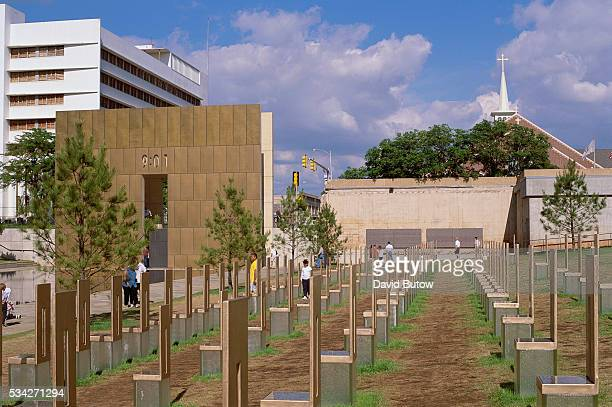 Visitors to the Oklahoma City National Memorial walk among empty chairs that signify those lost in the Oklahoma City bombing On April 19 Timothy...