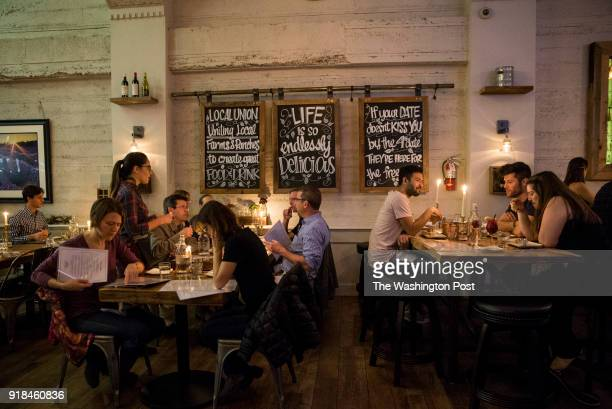 Visitors to the restaurant Local Union 271 sit down to dinner at the business located on University Avenue in Palo Alto California on February 8 2018