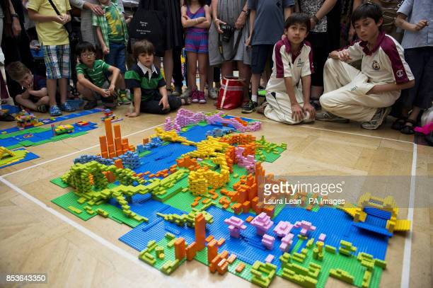 Visitors to the Royal Academy admire the design of Zaha Hadid Architects at the UK's first Lego battle inside the Royal Academy's Summer Exhibition...