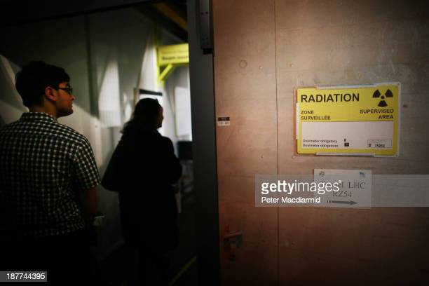 Visitors to the Science Museum walk through the 'Collider' exhibition's recreation of the Large Hadron Collider on November 12 2013 in London England...