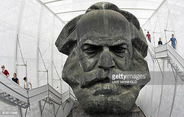 Visitors to the socalled Temporary Museum of Modern Marx walk on the steps past the plastic bust sculpture of German communist theorist Karl Marx in...
