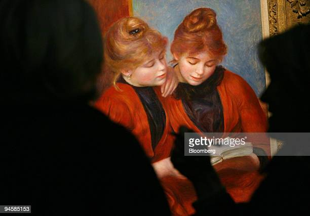 Visitors to the Sotheby's galleries look at a painting by PierreAuguste Renoir entitled ''Les Deux Soeurs'' in London UK Wednesday Jan 31 2007...