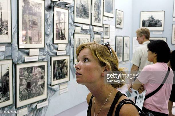 Visitors to the War Remnants Museum reflect on the moving exhibition of Vietnam War photographs including the devastating effects of napalm attacks...