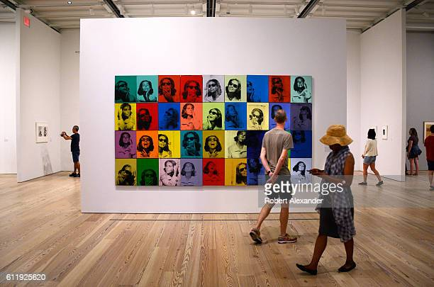 Visitors to the Whitney Museum of Art in New York City view a painting by Andy Warhol titled 'Ethel Scull 36 Times' Warhol compled the screen...