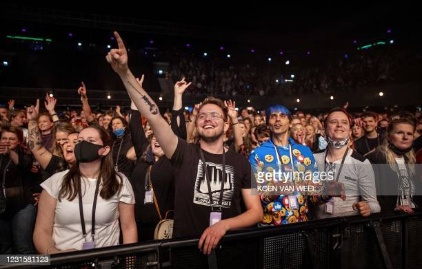 Visitors to the Ziggo Dome attend a performance by Dutch musician Phil Bee part of a series of trial events in which Fieldlab is investigating how...