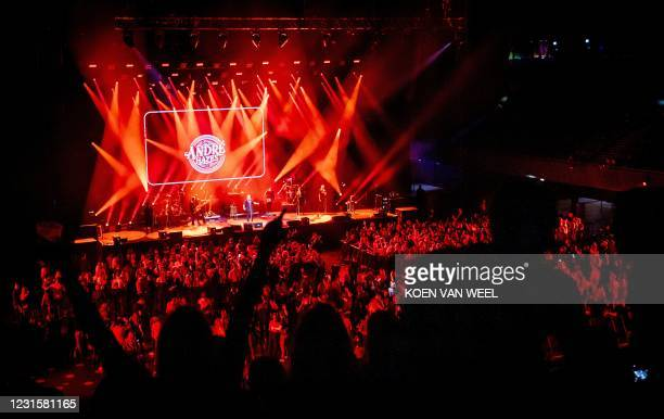 Visitors to the Ziggo Dome attend a performance by Dutch singer Andre Hazes part of a series of trial events in which Fieldlab is investigating how...