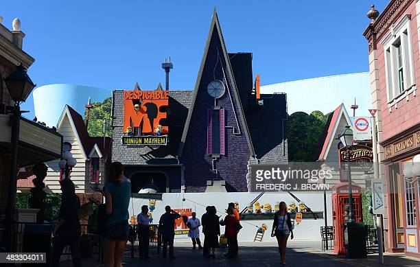 Visitors to Universal Studios are seen outside the Despicable Me Minion Mayhem attraction as it was still under construction on February 14 2014 in...