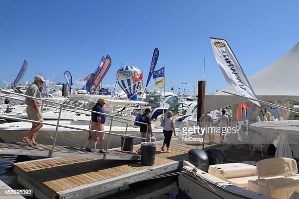 visitors to west palm beach boat show - palm beach county stock photos and pictures