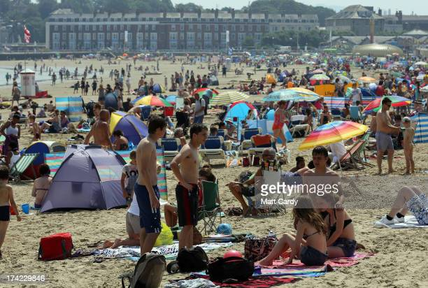 Visitors to Weymouth crowd onto the beach on July 22 2013 in Weymouth England According to forecasters the current warm fine weather that parts of...