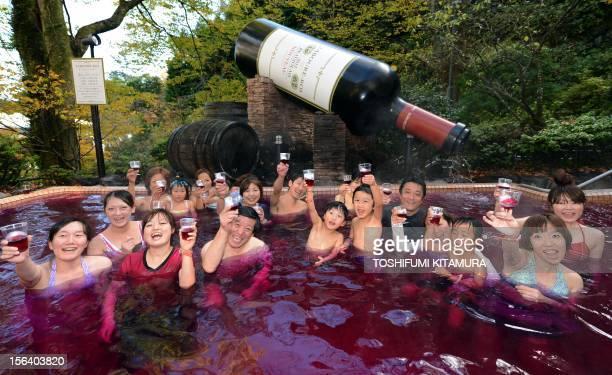 Visitors toast 2012 Beaujolais Nouveau wine while enjoying the wine spa at the Hakone Yunessun spa resort facilities in Hakone town Kanagawa...