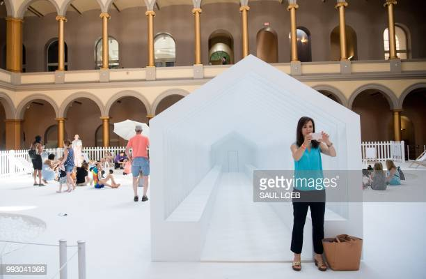 Visitors tour Fun House a freestanding structure designed by Snarkitecture that recalls and reimagines the idea of a traditional home at the National...