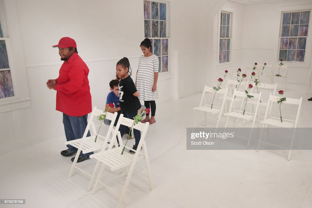 Visitors tour the First Baptist Church of Sutherland Springs after it was turned into a memorial to honor those who died on November 12, 2017 in Sutherland Springs, Texas. The inside of the church has been painted white with 26 white chairs placed around the room. On each chair is a single rose and the name of a shooting victim. The chairs are placed throughout the room at the location where the victim died. Devin Patrick Kelley shot and killed the 26 people and wounded 20 others when he opened fire during Sunday service at the church on November 5th.