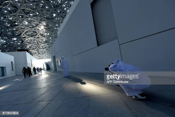 Visitors tour the Louvre Abu Dhabi Museum on November 11 2017 during its official opening to the public on Saadiyat island in the Emirati capital...