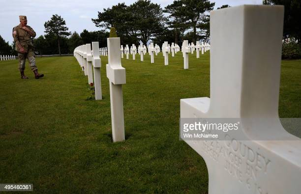 Visitors tour the Normandy American Cemetery above Omaha Beach June 3 2014 in CollevilleSurMer France June 6 is the 70th anniversary of the DDay...