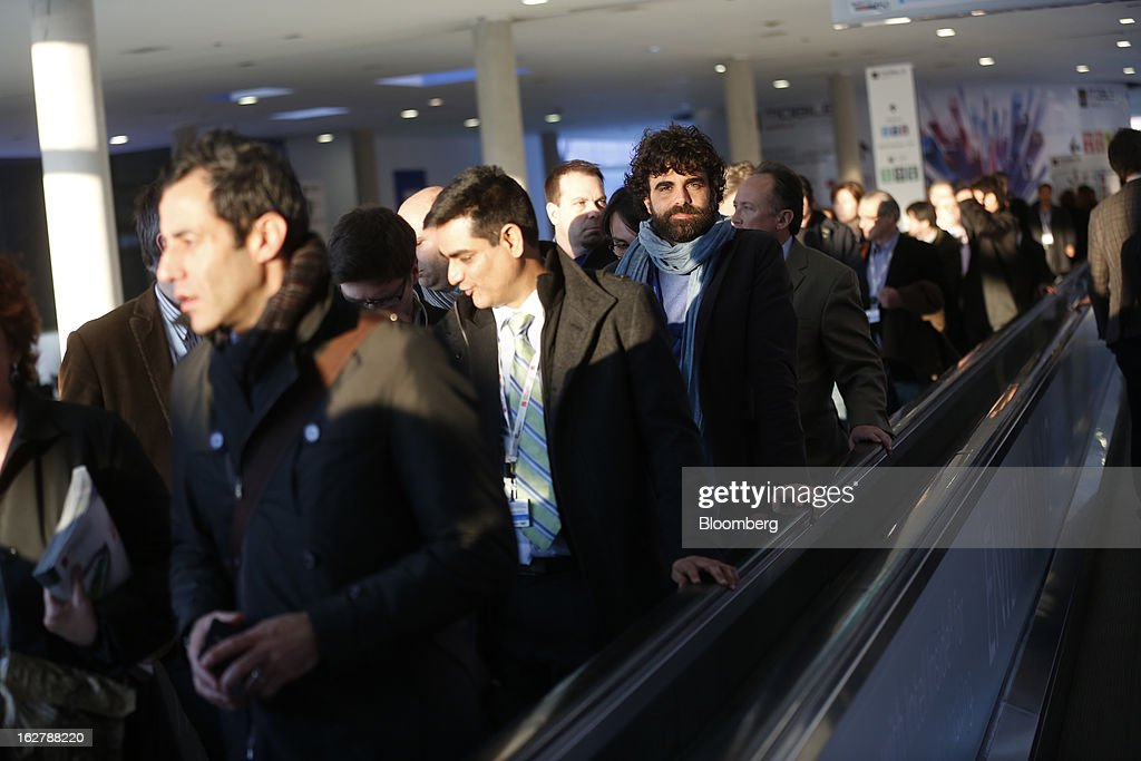 Visitors travel along a moving walkway as they exit the Mobile World Congress in Barcelona, Spain, on Tuesday, Feb. 26, 2013. The Mobile World Congress, where 1,500 exhibitors converge to discuss the future of wireless communication, is a global showcase for the mobile technology industry and runs from Feb. 25 through Feb. 28. Photographer: Simon Dawson/Bloomberg via Getty Images