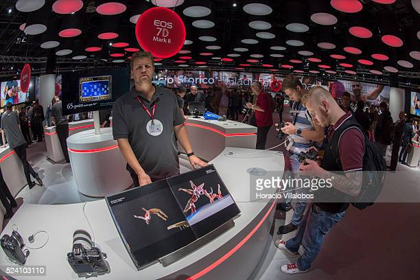 Visitors try cameras at Canon stand in Photokina 2014 in Cologne Germany 18 September 2014 Photokina the world's leading imaging fair brings together...