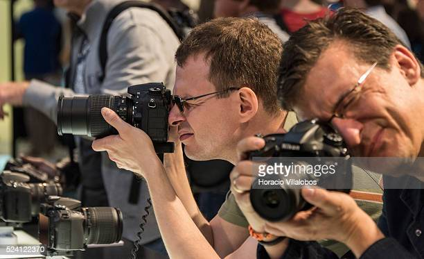 Visitors try cameras at Nikon stand in Photokina 2014 in Cologne Germany 18 September 2014 Photokina the world's leading imaging fair brings together...
