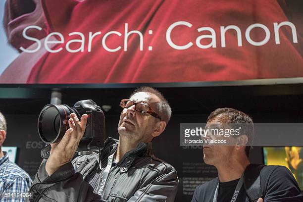 Visitors try equipment at Canon stand in Photokina 2014 in Cologne Germany 18 September 2014 Photokina the world's leading imaging fair brings...