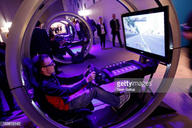 Visitors try out 3D video games at the Sony stand at the 2010 IFA technology and consumer electronics trade fair at Messe Berlin on September 3 2010...
