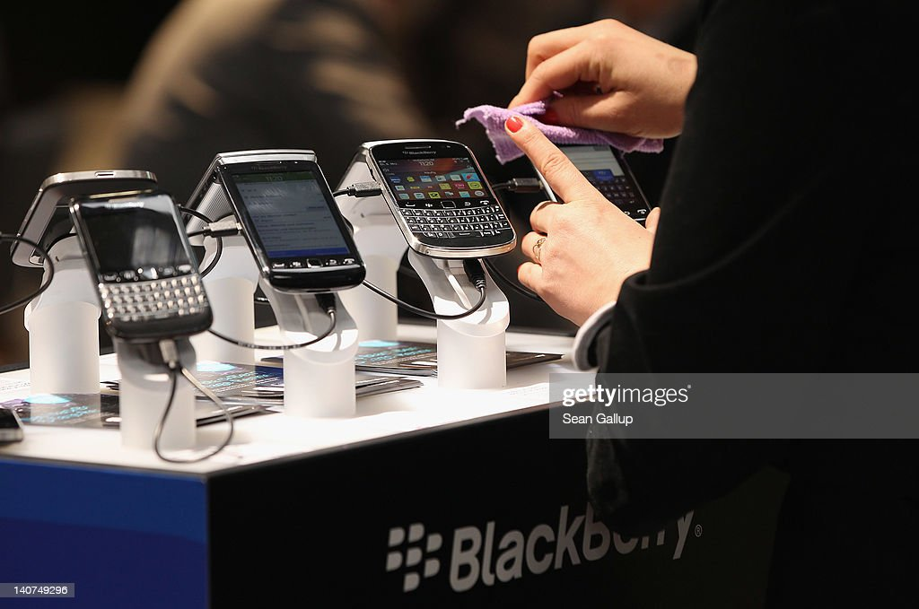 Visitors try out Blackberry smartphones at the Blackberry stand on the first day of the CeBIT 2012 technology trade fair on March 6, 2012 in Hanover, Germany. CeBIT 2012, the world's largest information technology trade fair, will run from March 6-10, and advances in cloud computing and security are major features this year.