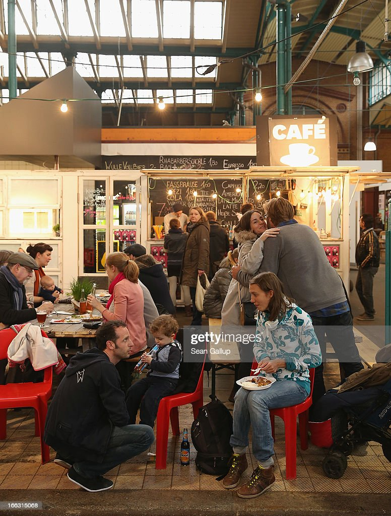 Visitors try out culinary delights from vendors on the first day of Street Food Thursday at the Markthalle Neun market hall in Kreuzberg district on April 11, 2013 in Berlin, Germany. Street Food Thursday features sidewalk delicacies from a variety of culinary traditions and will be open every Thursday from 5 until 11. Berlin has become a major tourist destination in Europe and has developed a reputation as a hip, affordable and open-minded city.