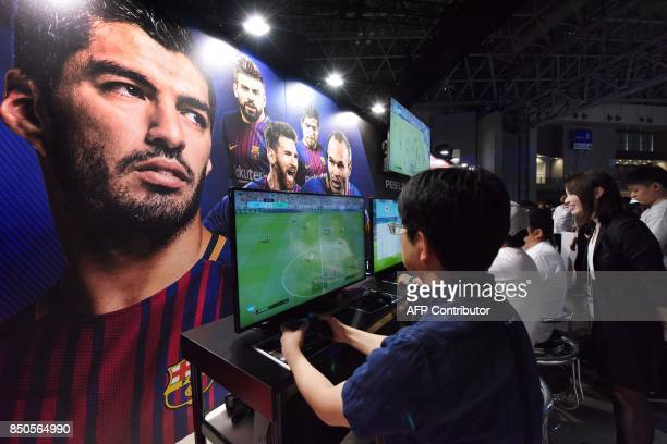 Visitors try out games at the Tokyo Game Show in Chiba City, suburban Tokyo on September 21, 2017. Top eSports players traded digital blows at a show...