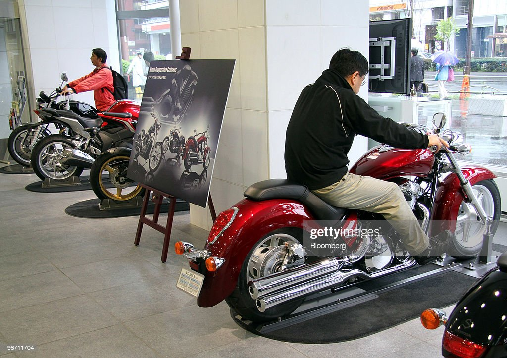 Visitors Try Out Honda Motor Cos Motorcycles At The Companys Headquarters In Tokyo