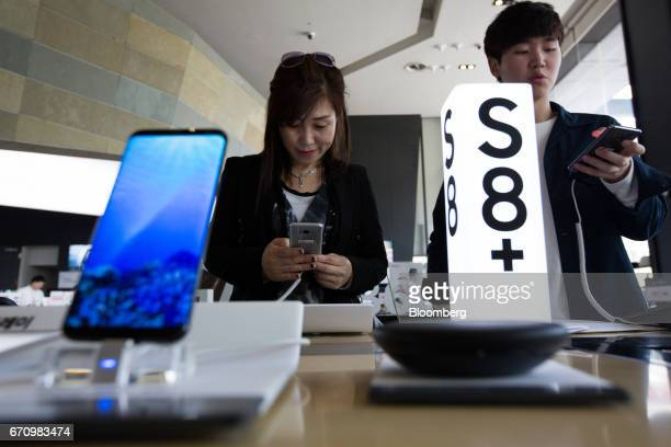 Visitors try out Samsung Electronics Co Galaxy S8 smartphones at KT Corp's Olleh Square flagship store in Seoul South Korea on Friday April 21 2017...