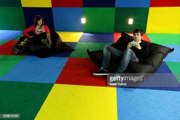 Visitors try out video games at the 2010 IFA technology and consumer electronics trade fair at Messe Berlin on September 3 2010 in Berlin Germany The...