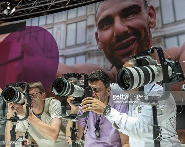 Visitors try telephoto lenses and cameras at Canon stand in Photokina 2014 in Cologne Germany 18 September 2014 Photokina the world's leading imaging...
