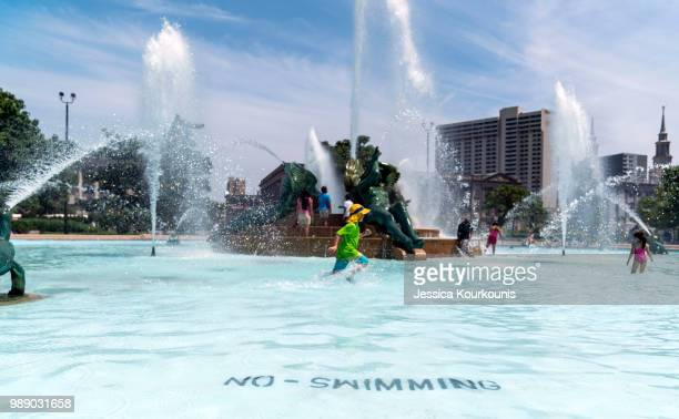 Visitors try to cool off in a downtown fountain in sweltering heat on July 1 2018 in Philadelphia Pennsylvania An excessive heat warning has been...