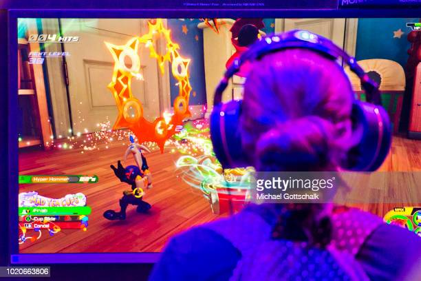 247f424d7ecb Visitors try video games at 2018 gamescom fair press day on August 21 2018  in Cologne