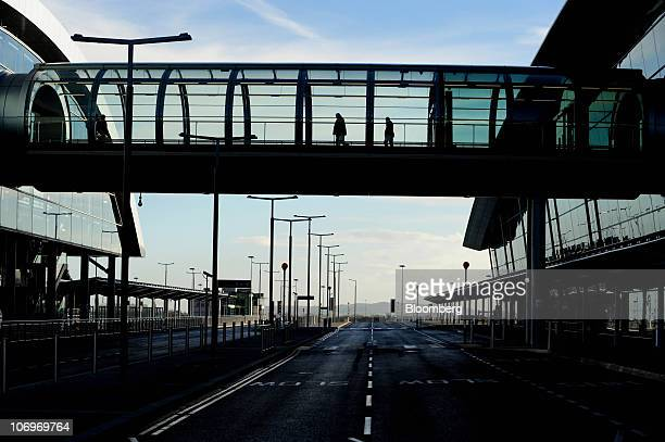 Visitor's use a walkway at Dublin airport's Terminal 2 in Dublin Ireland on Friday Nov 19 2010 The Dublin Airport Authority said two days ago that...