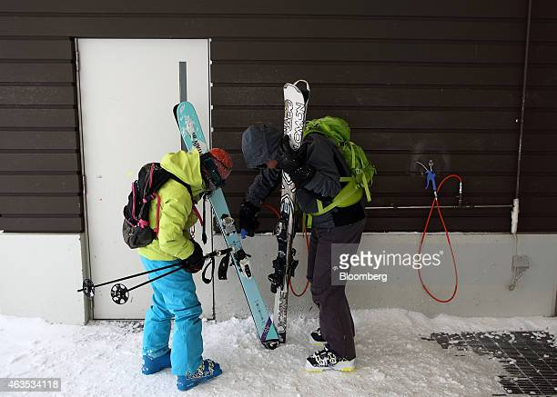 Visitors use air dusters after skiing at the Niseko Hanazono resort operated by Nihon Harmony Resorts KK in Kutchan Hokkaido Japan on Sunday Feb 15...
