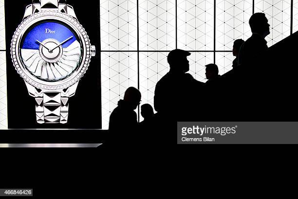 Visitors use the staircase in front of a Dior display at Baselworld 2015 on March 19 2015 in Basel Switzerland