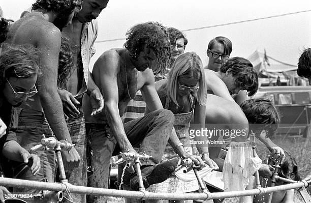 Visitors use the taps to refresh themselves at the Woodstock Music Art Fair Bethel NY August 15 1969
