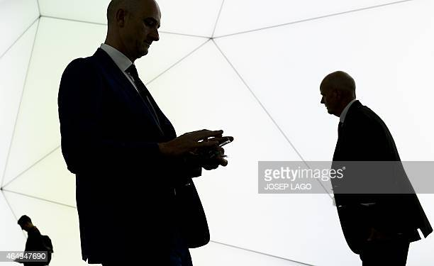 Visitors use their mobile devices during the opening day of the 2015 Mobile World Congress in Barcelona on March 2 2015 Phone makers will seek to...