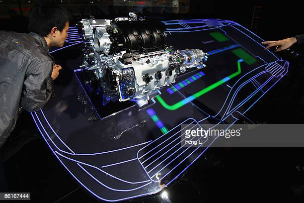 Visitors veiw the Lexus hybrid drive during a special trade visitors opening of the Auto Shanghai 2009 at Shanghai New International Expo Center on...