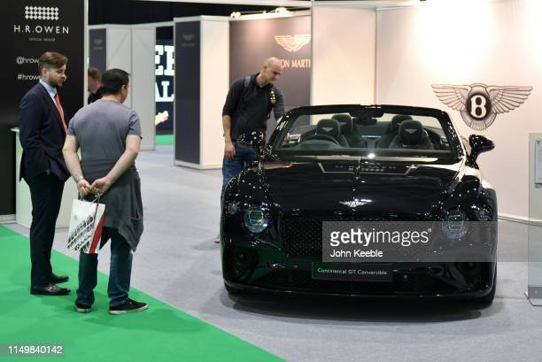 Visitors view a Bentley Centenary Specification Continental GT Convertible is displayed during the London Motor and Tech Show at ExCel on May 16,...