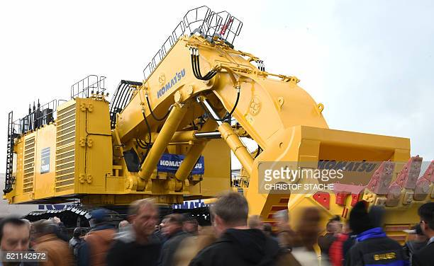 """Visitors view a big Komatsu excavator at the open exhibition area of the world's largest construction trade fair, the """"Bauma 2016"""" in Munich, on..."""